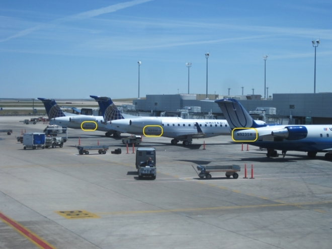 Photo of several regional jets with the tail numbers highlighted