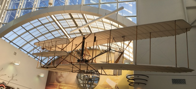 Photo of Wright Flyer suspended above the Dayton airport's lobby