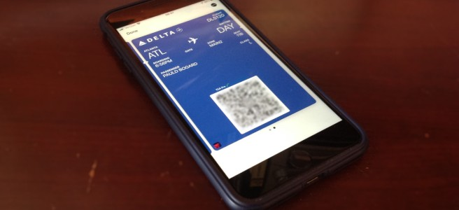 Photo of a phone displaying a digital boarding pass