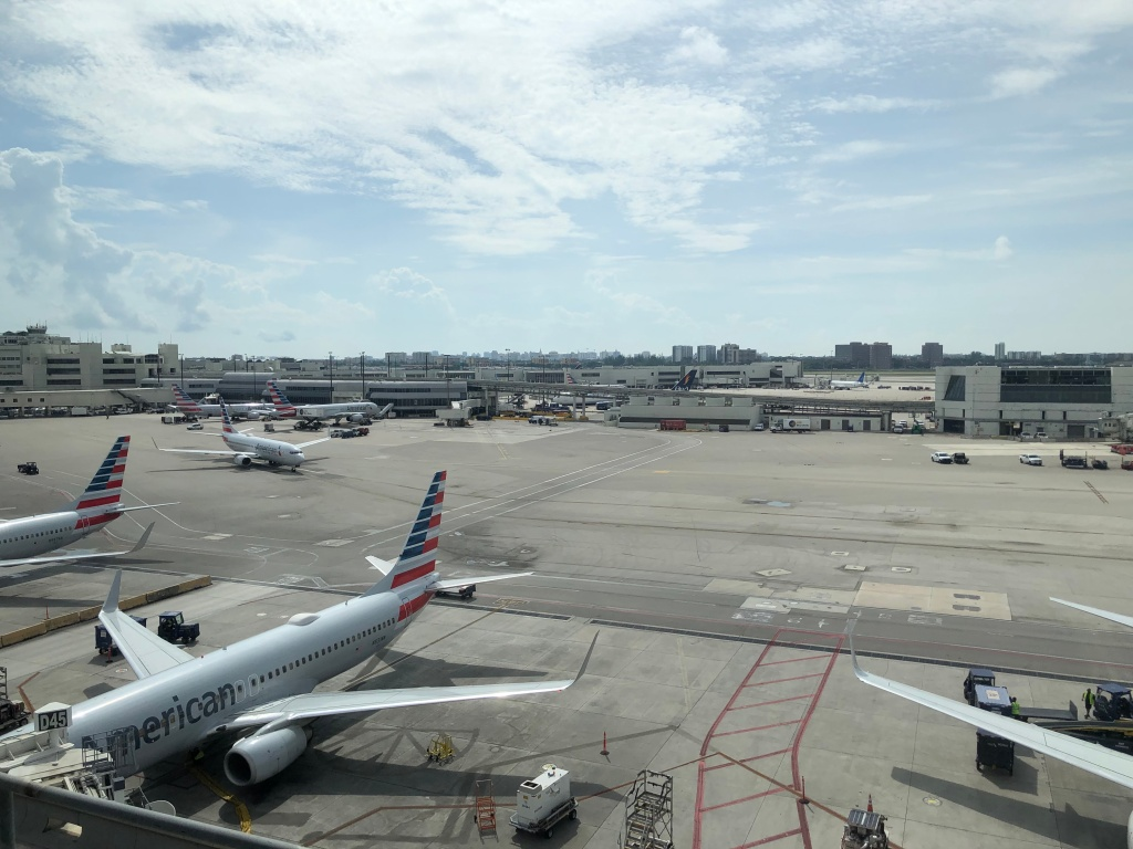 Photo of MIA Concourse E, with the satellite on the right and the pier on the left.