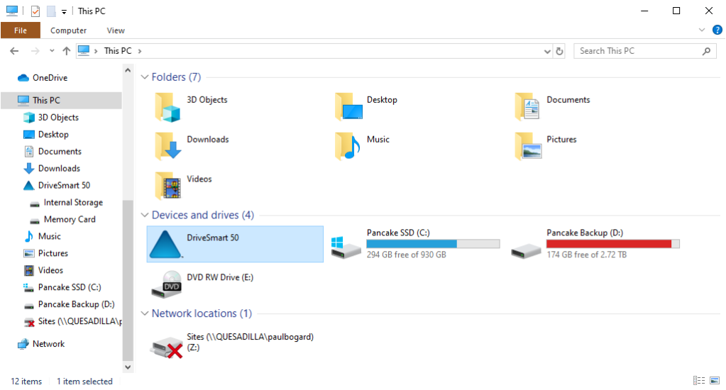 "Screenshot of the Windows 10 ""This PC"" folder in File Explorer, with DriveSmart 50 highlighted under ""Devices and drives"""